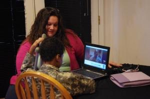Gilchrist Kids Nurse, Cora Goecke with Khalil.